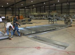 Panel construction at Hattiesburg - coils and rollformers in background